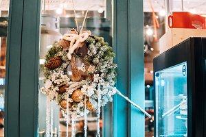 Christmas wreath hanging on the glass door