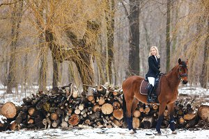 pretty woman posing on horse