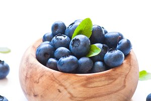 Fresh blueberriaes in wooden bowl.
