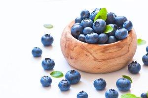 Fresh blueberriaes in wooden bowl.
