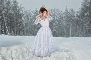 Woman in snowy woods.