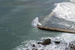 Wave fills a small jetty.