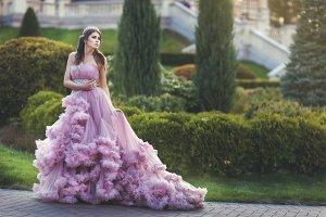Woman queen, in a long dress.