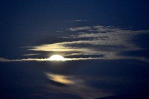 full moon being born