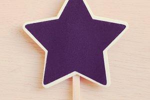Star shape blackboard on wood