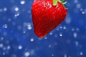 red strawberry under drops