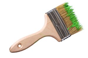 wooden brush with green paint