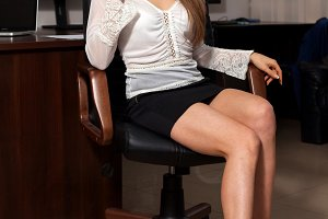 Secretary sits on the chair
