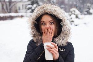 Woman drinking hot coffee or tea