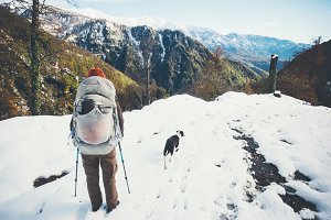 Backpacker with dog hiking