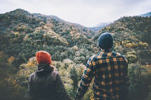 Couple holding hands mountains view