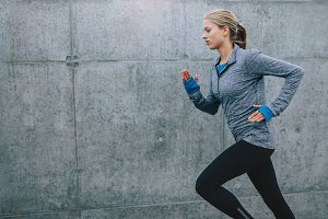 Healthy young woman jogging