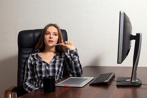 Businesswoman is retouching photos