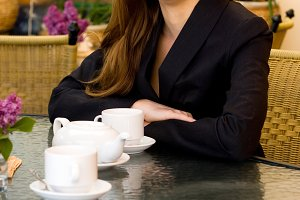woman in black suit in cafe