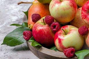 Fresh raspberries and apples