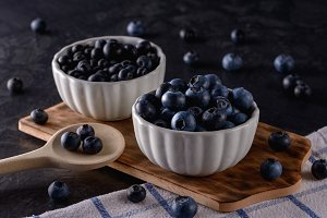 Blueberries in white bowls