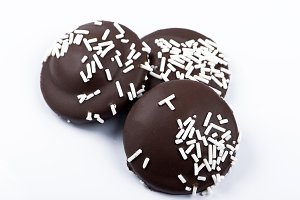 Chocolate biscuit with coconut flakes