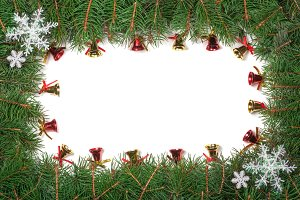 Christmas frame made of fir branches decorated with snowflakes and bells isolated on white background