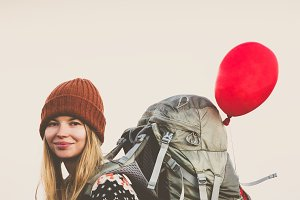 Happy Woman Traveler with backpack