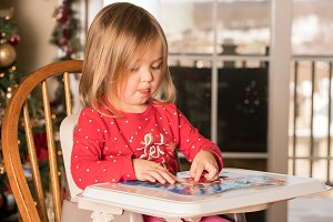 Young girl toddler making a jigsaw