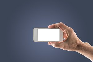 Male right hand holding smartphone with blank screen