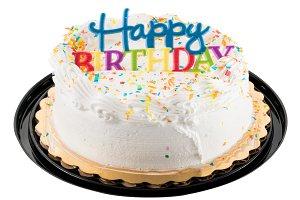 Happy birthday sign on white iced cake
