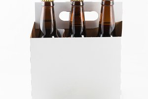 Six bottles of beer with in cardboard carrier