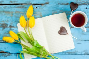 Tea, choco hearts, tulips & notebook