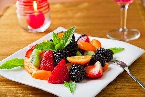 Fruit salad with berries, kumquats