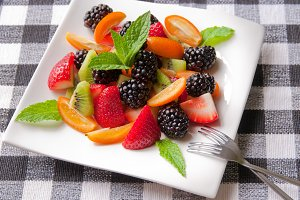 Fruit salad with berries, kumquats