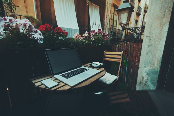workspace on balcony with laptop