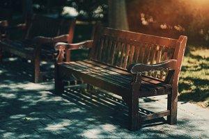 wooden maroon benches on sidewalk