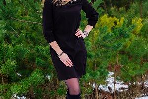 Girl posing in pines