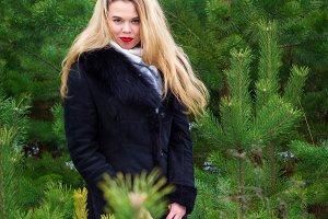 Woman posing in pines