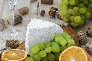 cheese with grapes and a glass of champagne