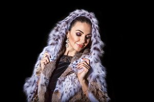 girl model posing in furs