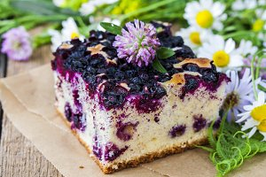 pie with blueberries on wooden table