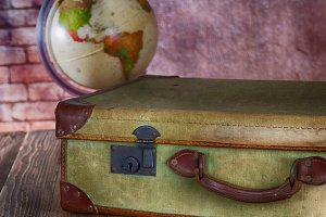 Antique Suitcase with World Ball