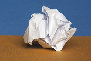 crumpled paper over brown blue background with copy space