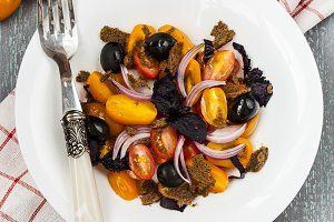 salad with tomatoes, olives and Basil