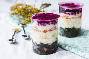 layered salad with sea cabbage, beets, potatoes and carrots