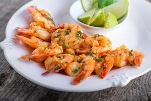 Fried Prawns with lime on a white plate