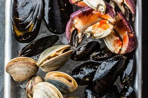 Uncooked fresh seafood Mussels, Clams, Vongole and Crabs