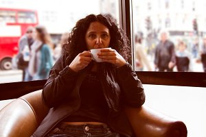 Pretty brunette drinking coffee tea