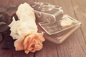Bouquet of roses and old photo