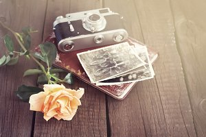 Yellow rose, album and family photos