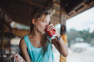 surf girl drinks Coca-Colla