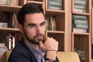 man touching beard handsome black