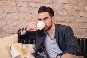 young man drinking coffee cup