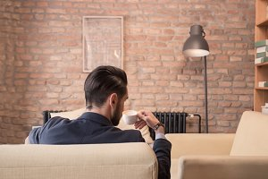 rear view man drinking coffee cup